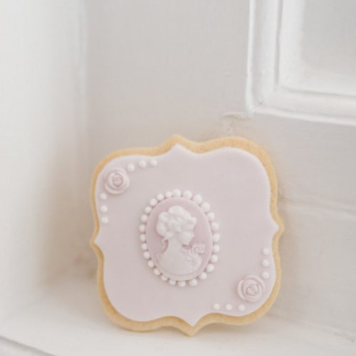 pink-cameo-and-flower-wedding-cookie_orig